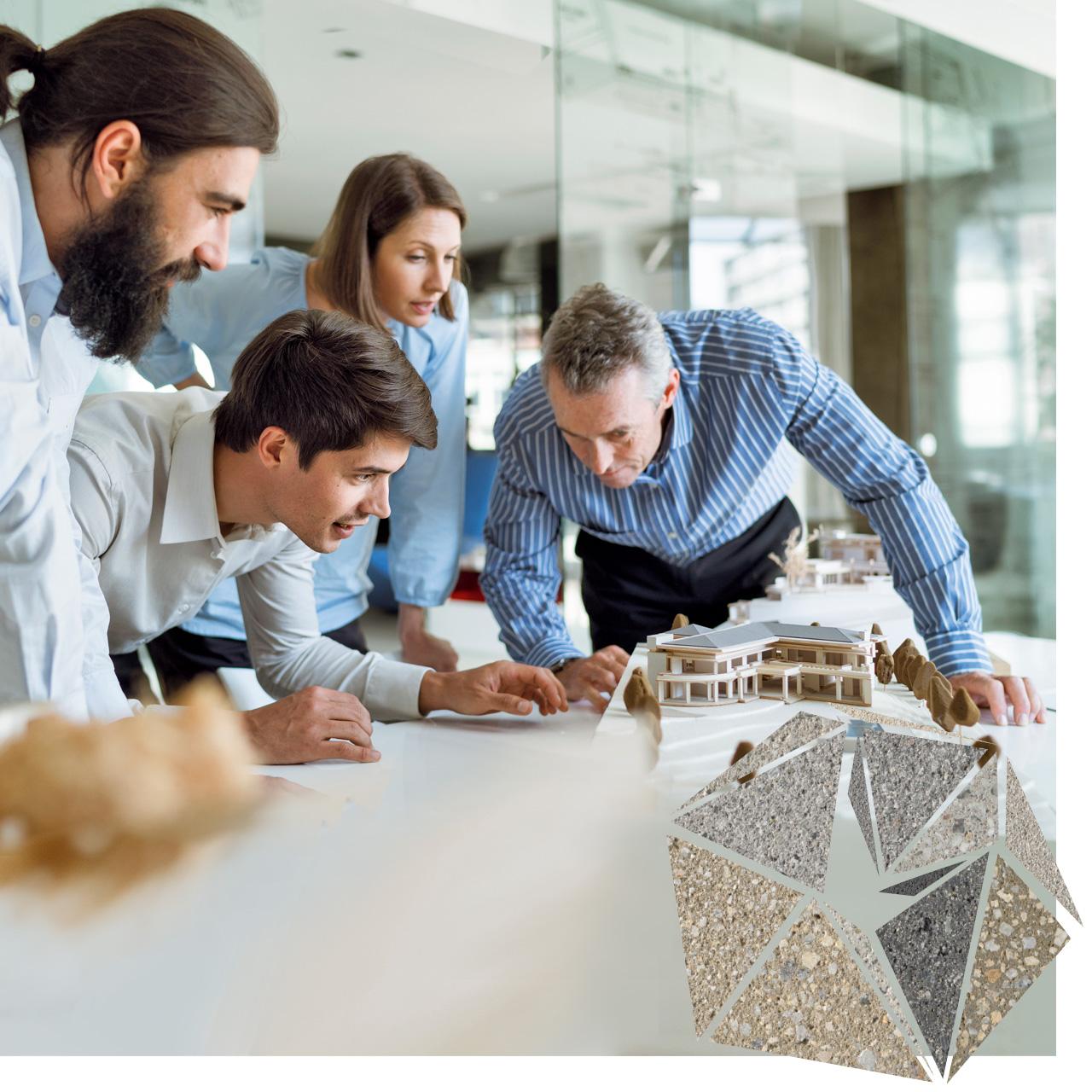 Architekten besprechen ein nachgebautes Projekt. Das neo³-Vorbild nube ist auch zu sehen.